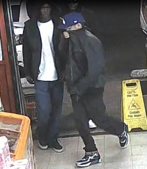 Second Suspect in Robbery Enters Store