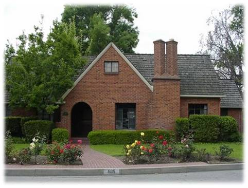 This unique red brick Tudor Revival style residence