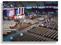 Arena room with chairs setup and the stage has the American flag as a back drop