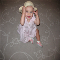 Baby in pink dress and a sunhat