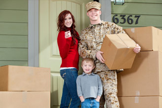 A man, woman, and child are moving into their new home