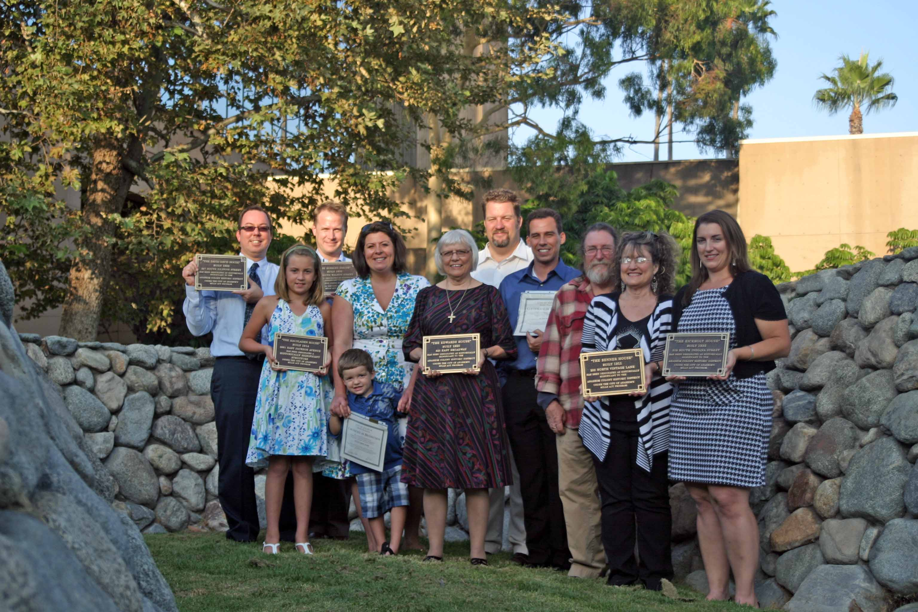 Group photo with the onwers holding their plaques for the Mills Act Participating Properties from 2010