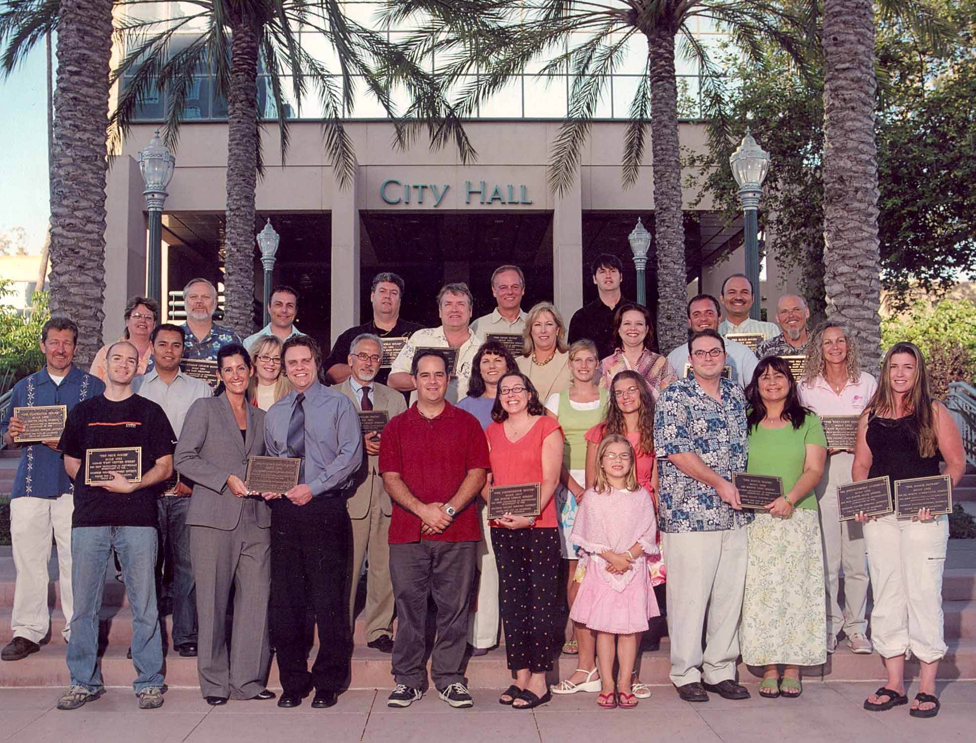 Group photo with the onwers holding their plaques for the Mills Act Participating Properties from 2004