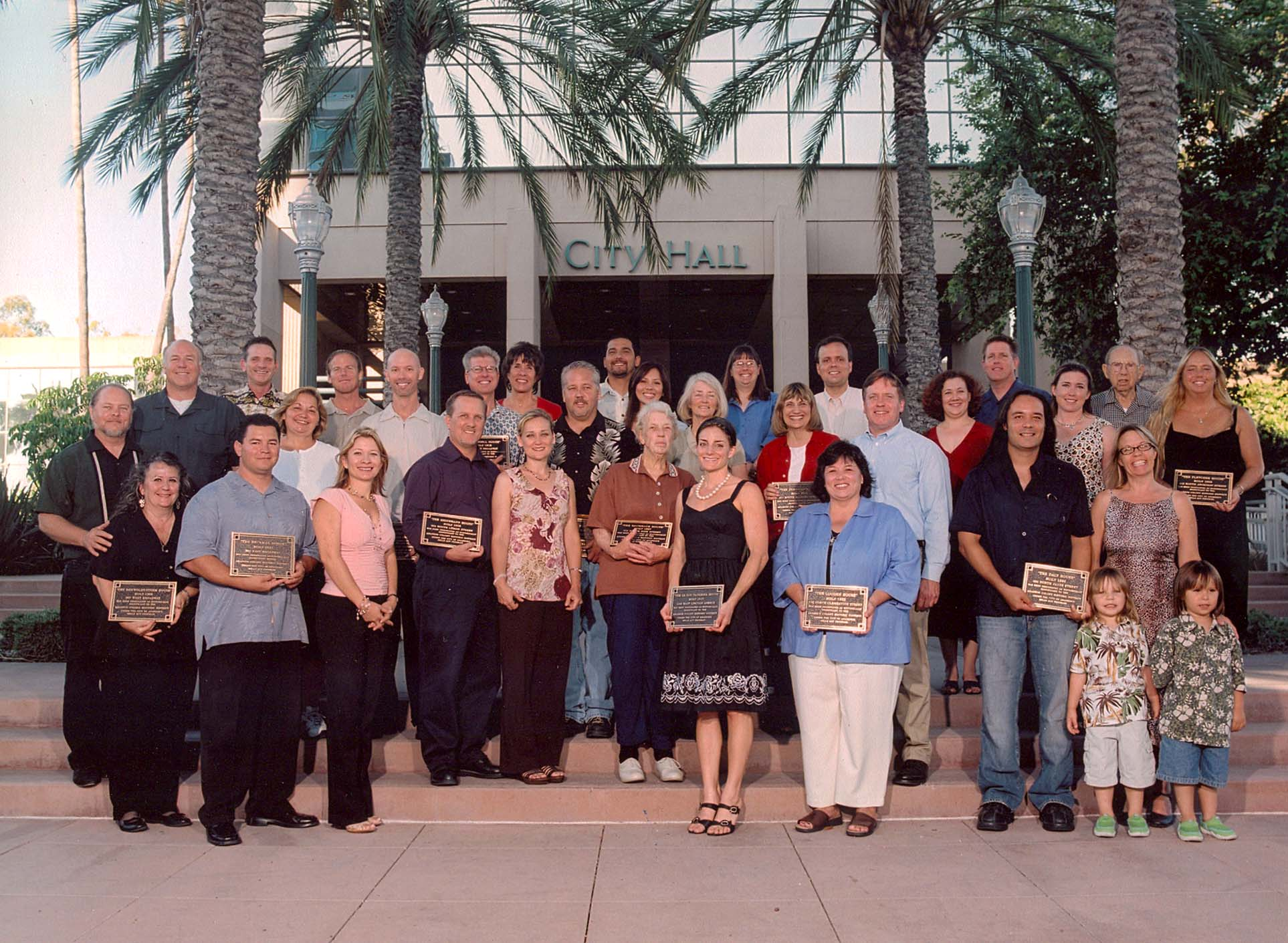 Group photo with the onwers holding their plaques for the Mills Act Participating Properties from 2005