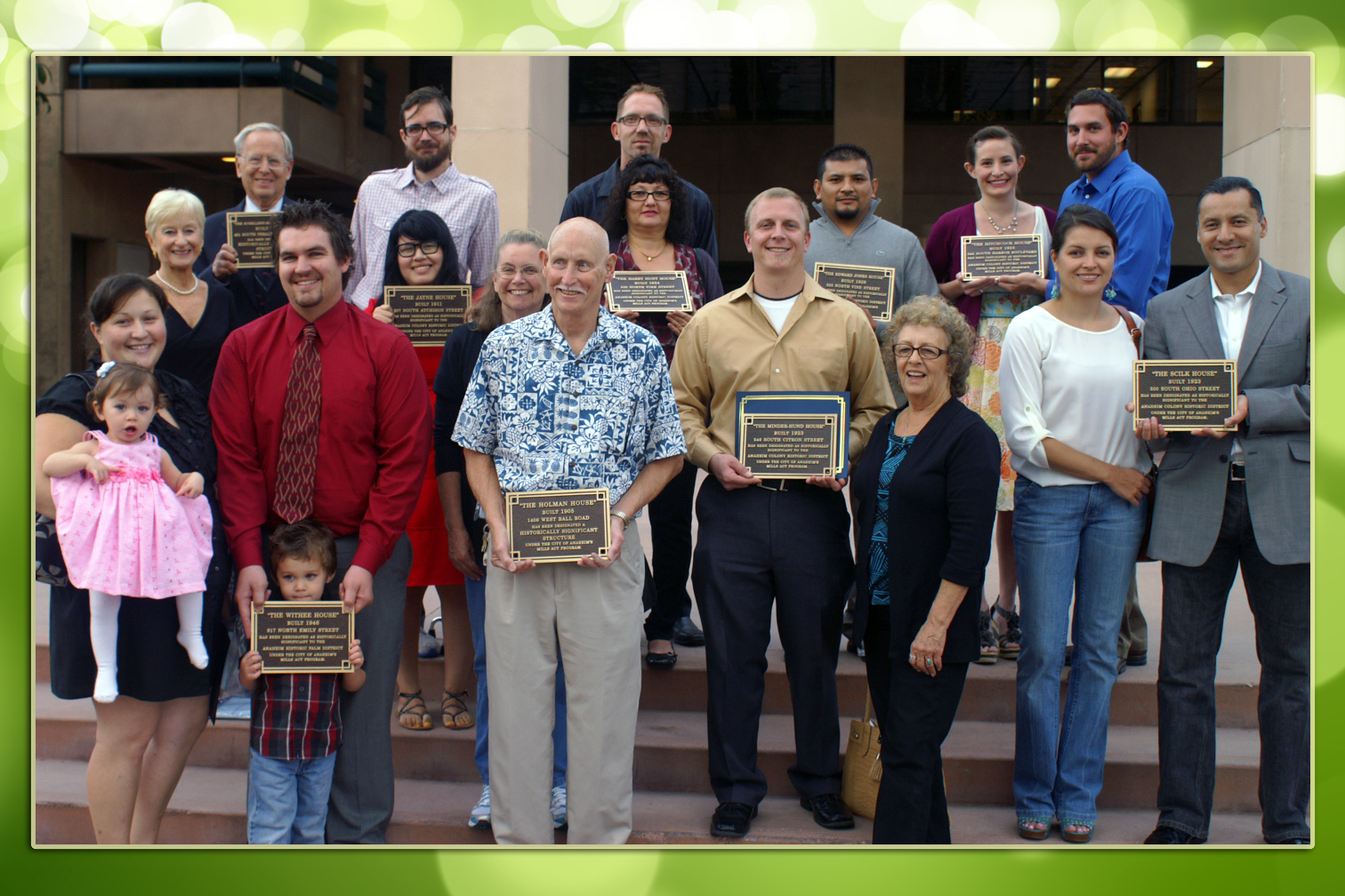 Group photo with the onwers holding their plaques for the Mills Act Participating Properties from 2011