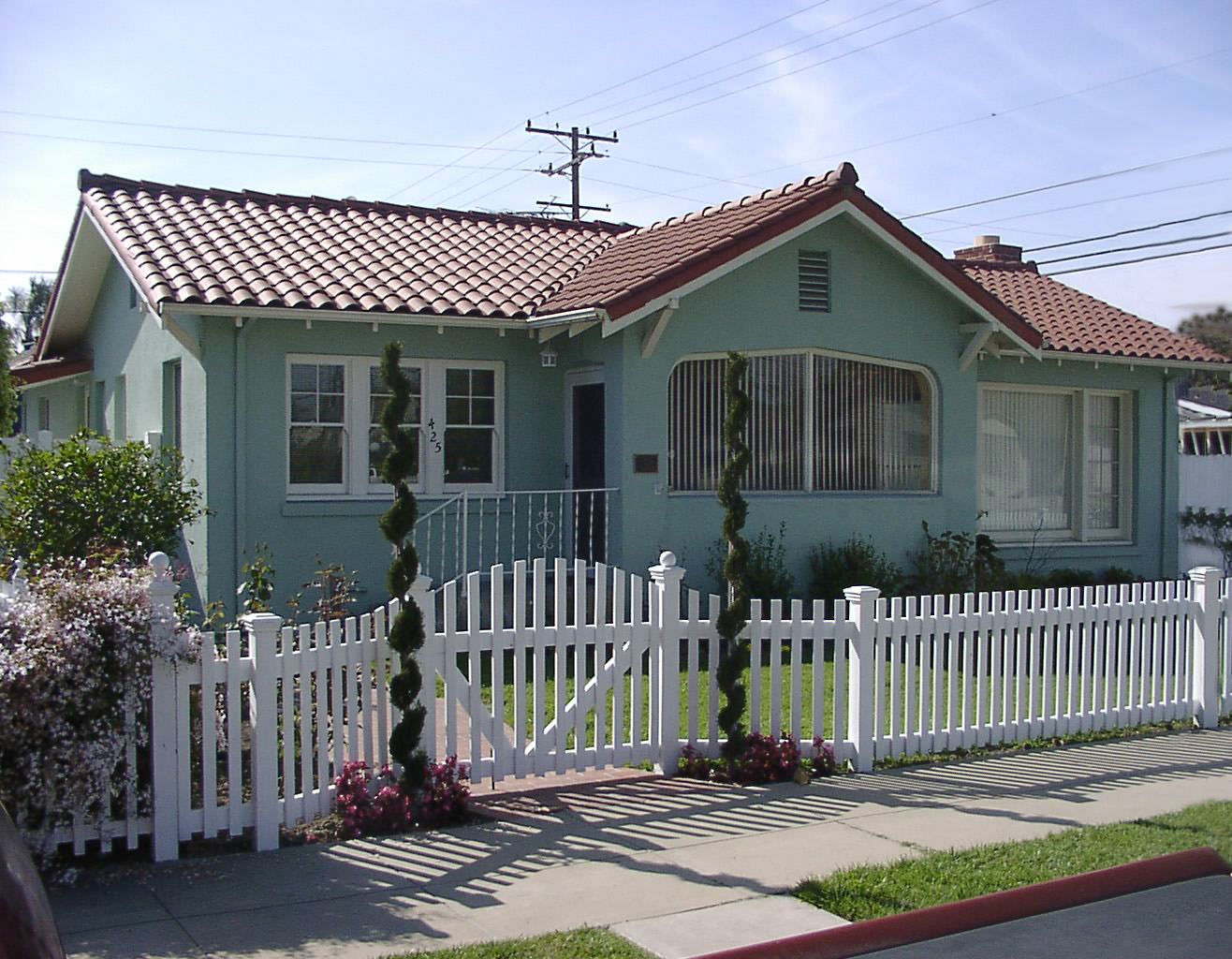 House with a white picket fence in the front yard
