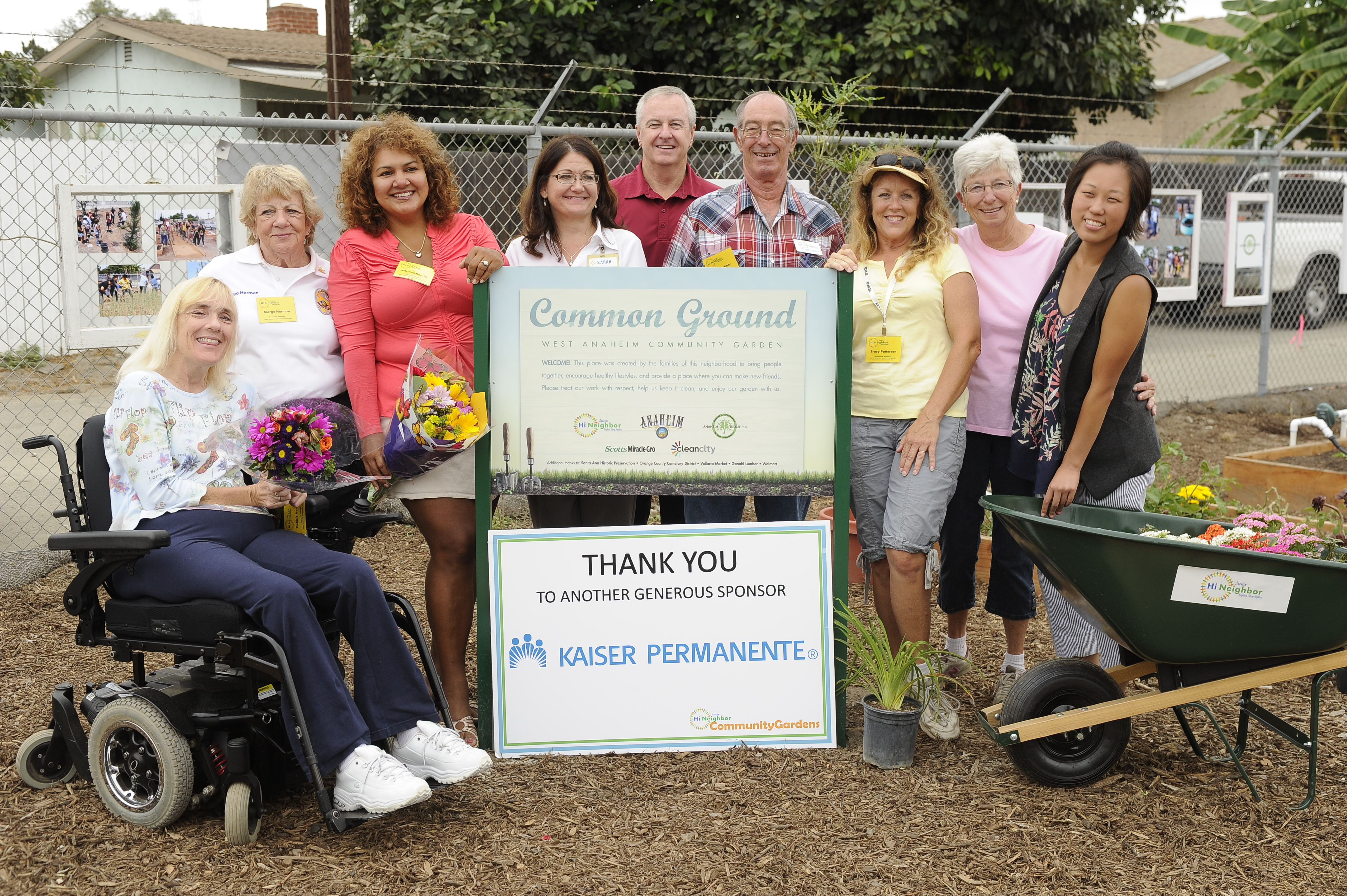 Group photo with the Common Grounds sign