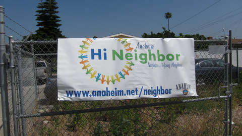 Hi Neighbor banner on the chain link fence