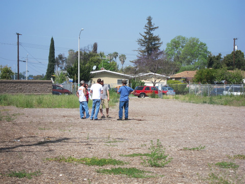 Group of people walking around the empty lot