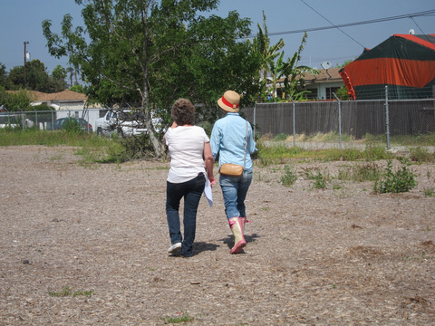 Two women walking around the empty lot