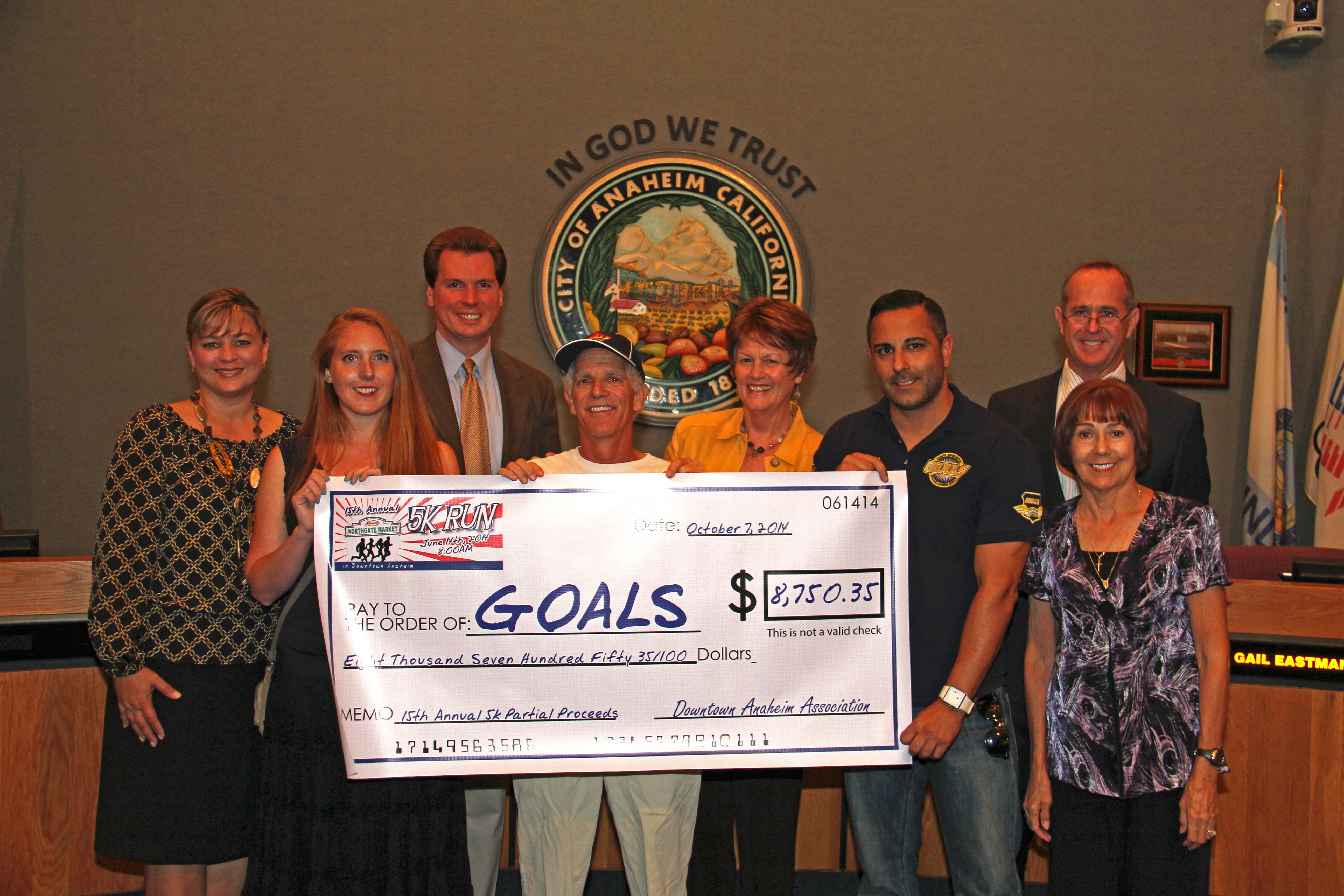 Giant check for the 15th annual 5k partial proceeds for Downtown Anaheim Association