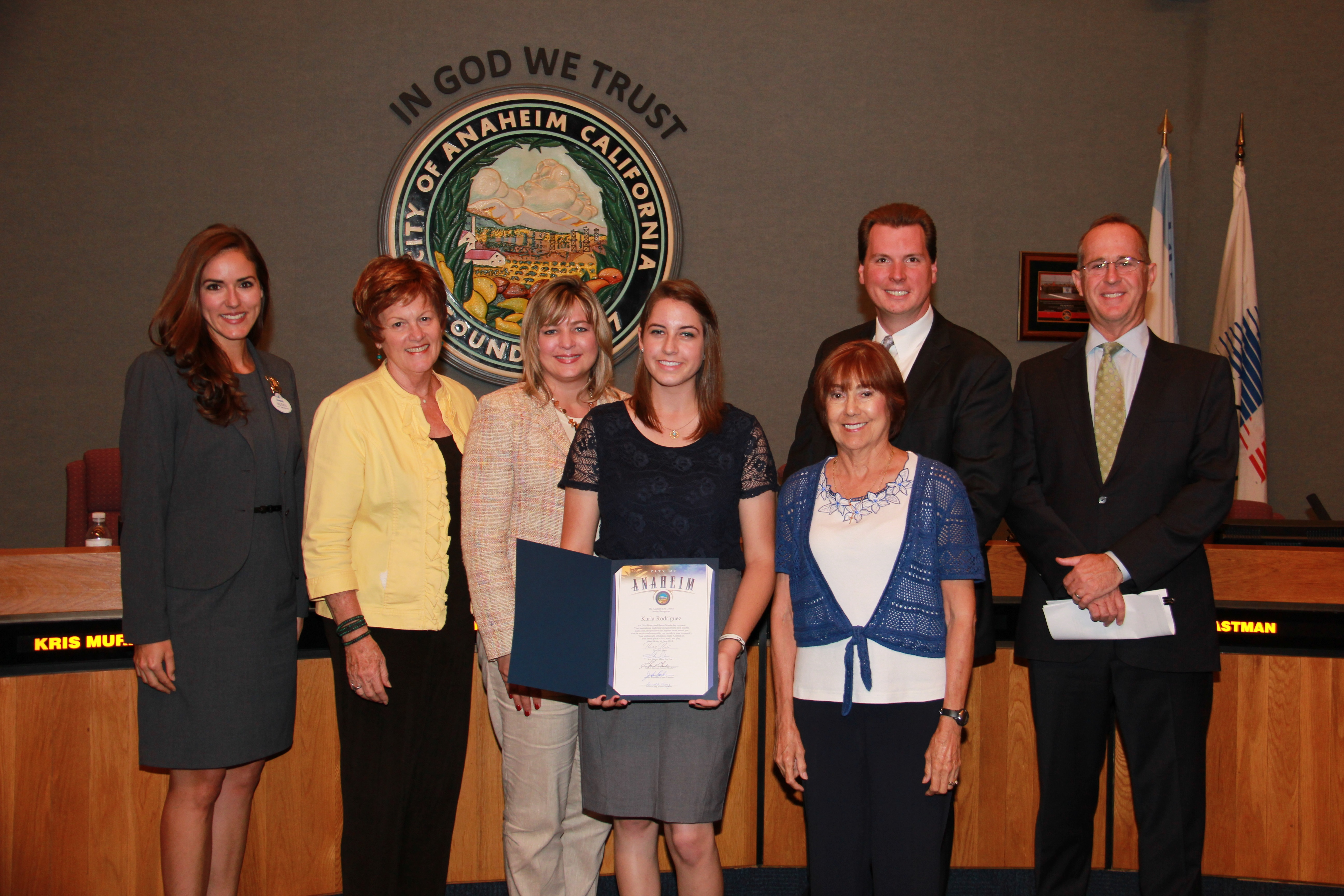Teenage girl receiving an award from the City Council