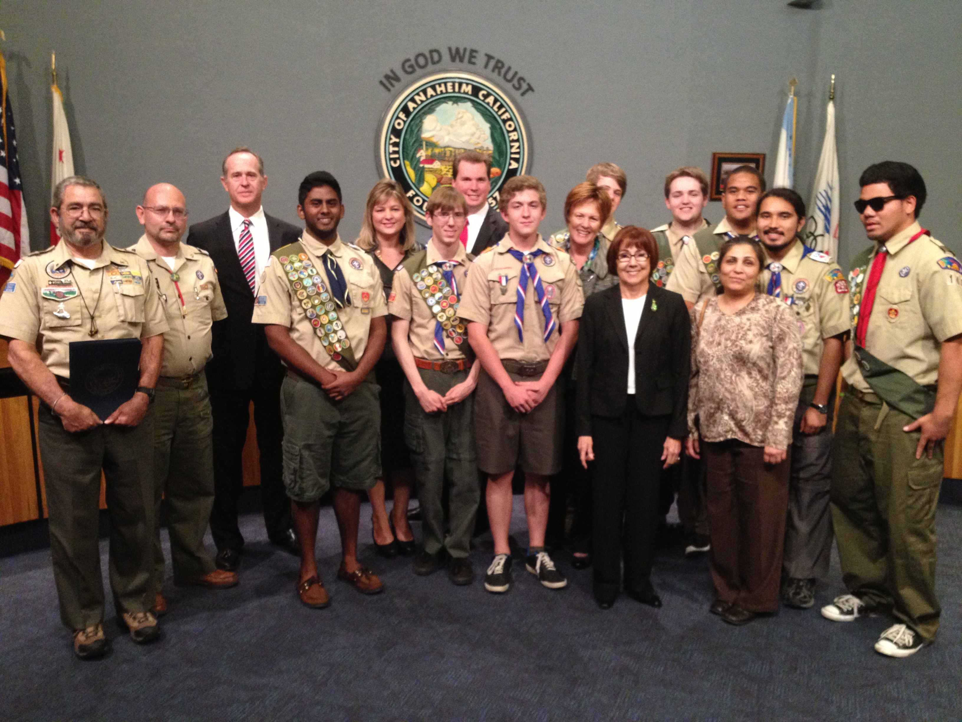 Group picture with the boy scouts, their leader, and the Council