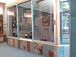 Large display cases at the Center Gallery displaying artwork
