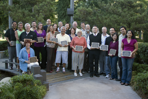 Group photo with the onwers holding their plaques for the Mills Act Participating Properties from 2009