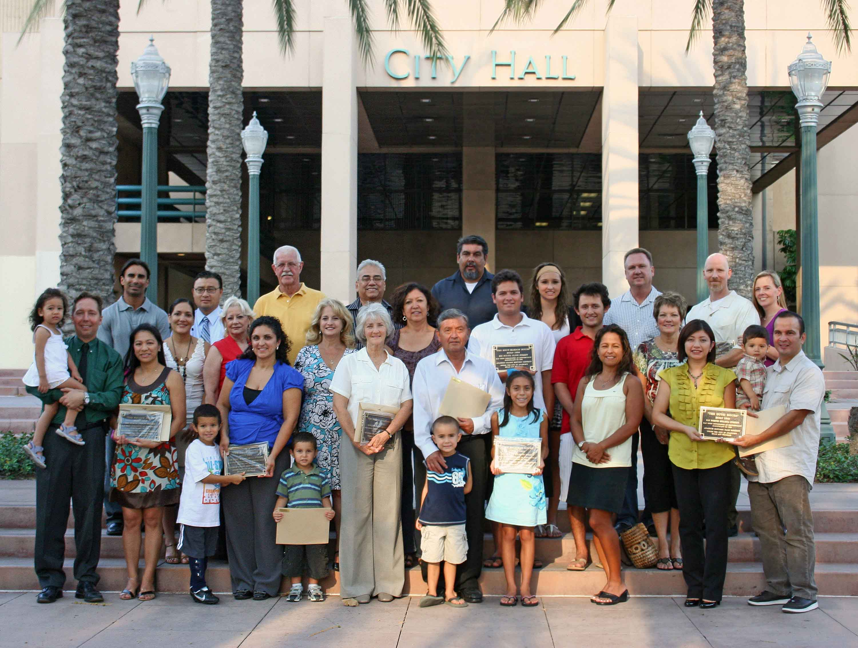 Group photo with the onwers holding their plaques for the Mills Act Participating Properties from 2008
