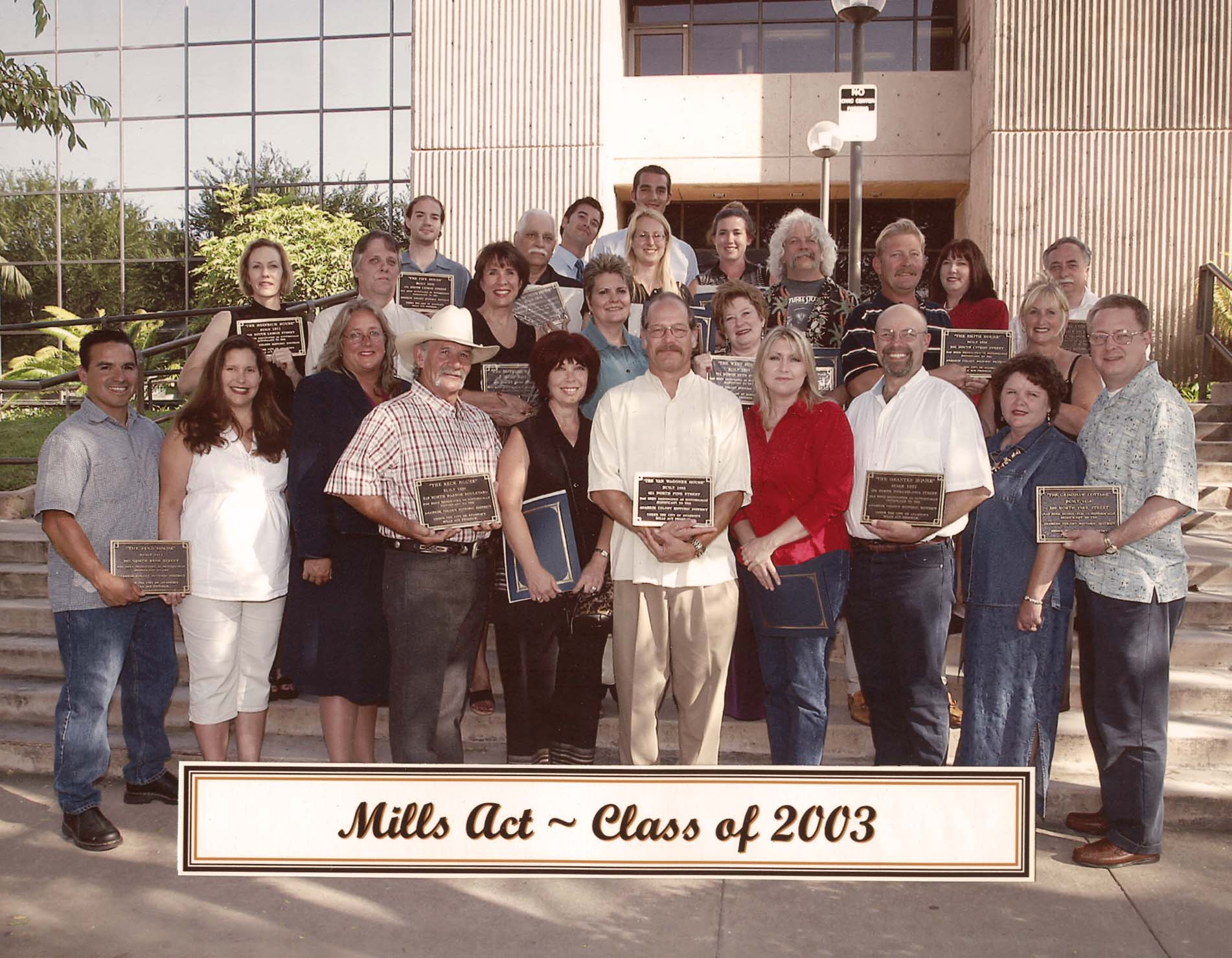 Group photo with the onwers holding their plaques for the Mills Act Participating Properties from 2003