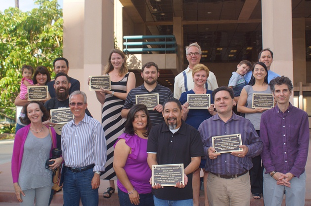 Group photo with the onwers holding their plaques for the Mills Act Participating Properties from 2012