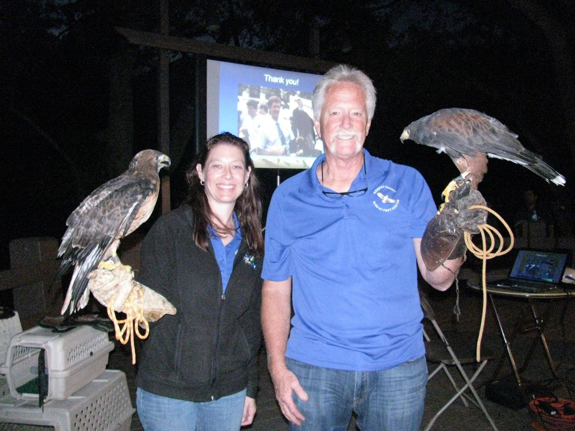 Man and woman hold large birds