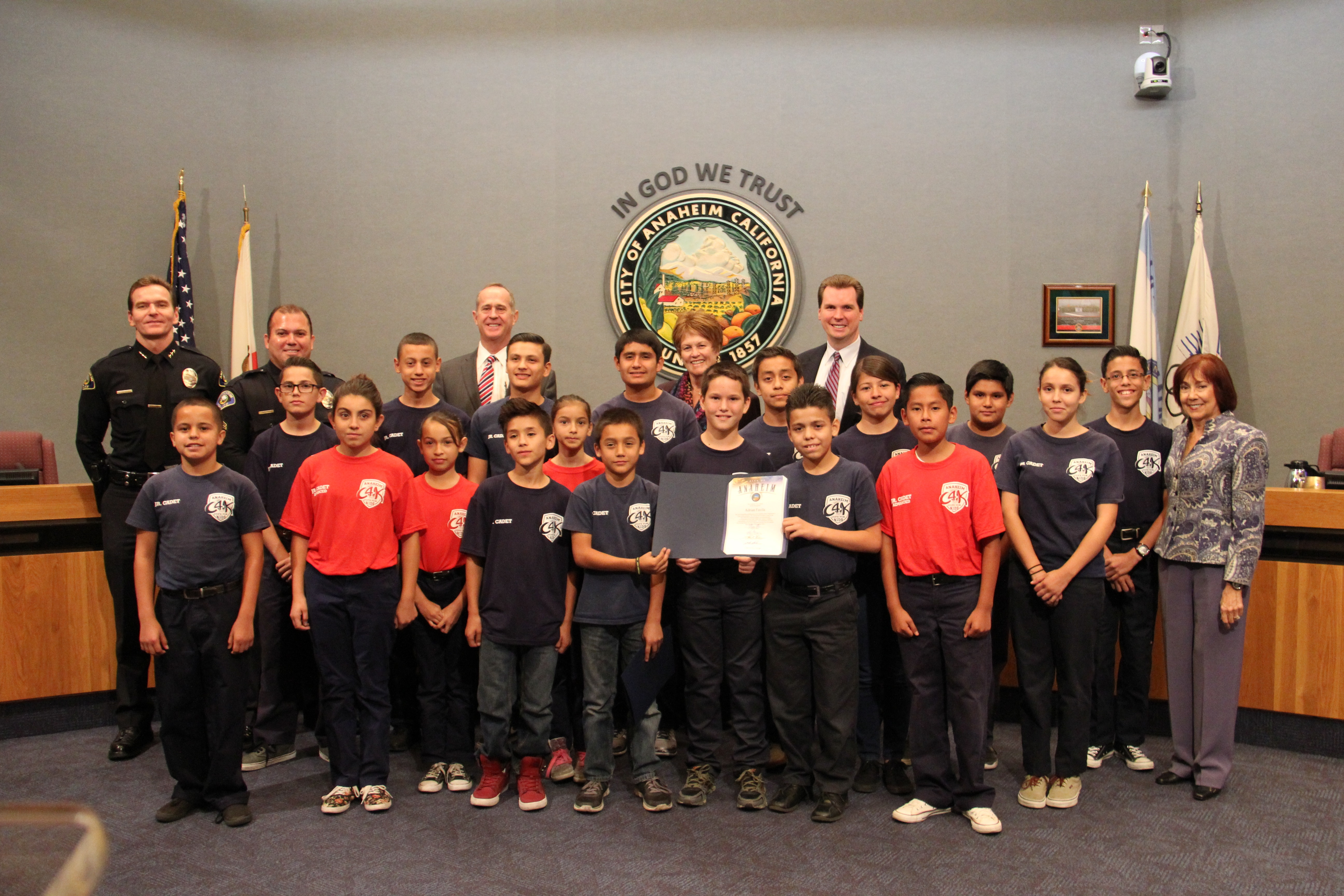 City Council photo with Councilmembers, Police Officer, and Jr. Cadets
